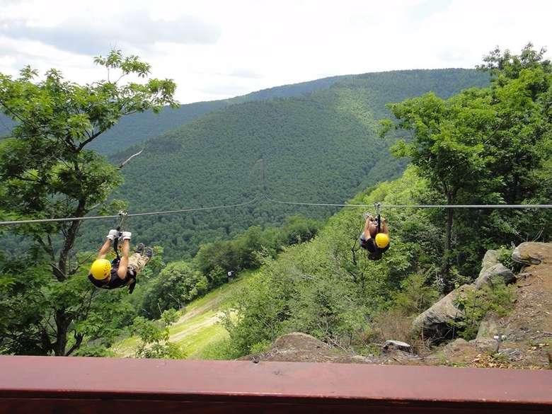 two people on dual ziplines