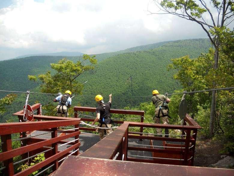 people preparing to go ziplining