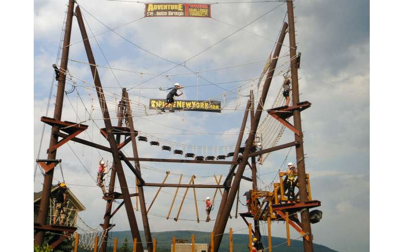 a large wooden outdoor adventure tower