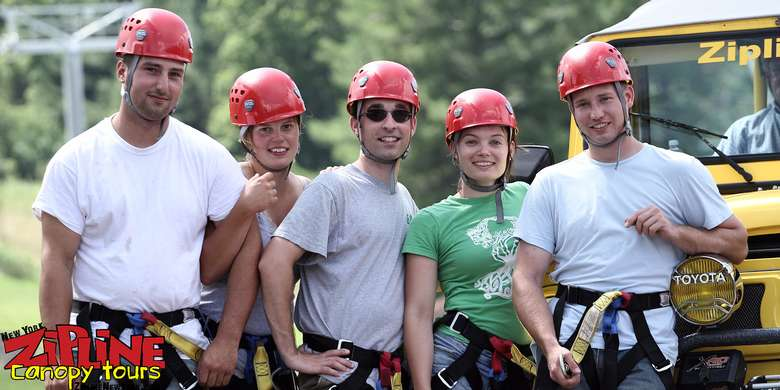 five people with red helmets