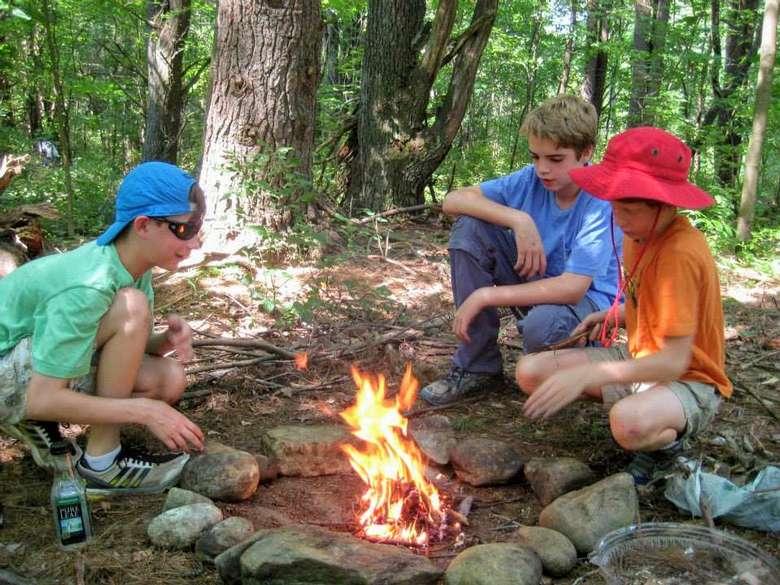 kids around a campfire