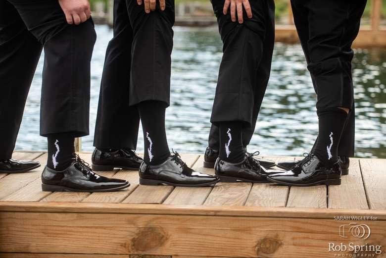 Groomsmen wearing a custom Silhouette of Lake George on a Navy Blue Sock.