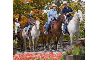 family of four on horses