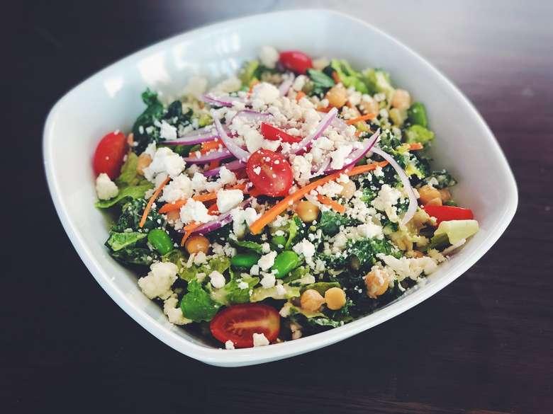 large salad in white bowl