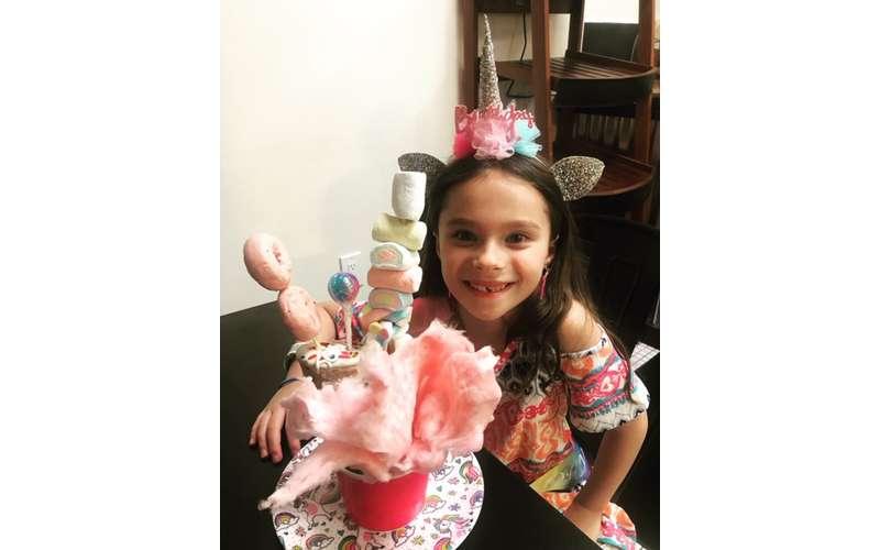 girl with cotton candy ice cream dessert