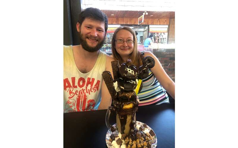 couple smiling in front of a freakshake
