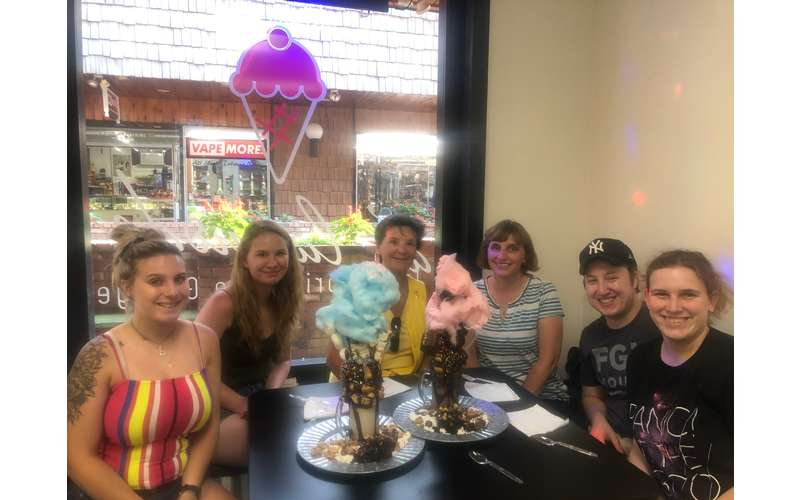 group of people with ice cream covered in cotton candy