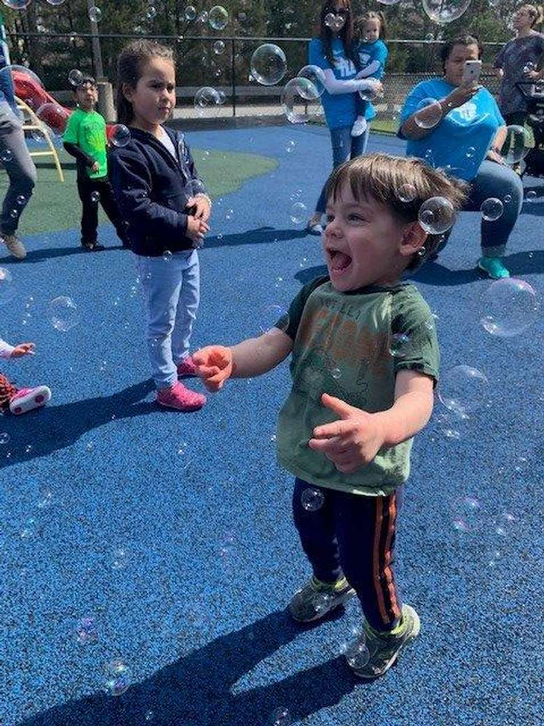 boy laughing at bubbles