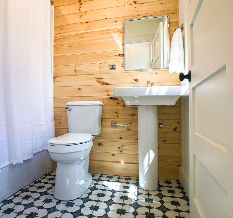 bathroom with wooden walls