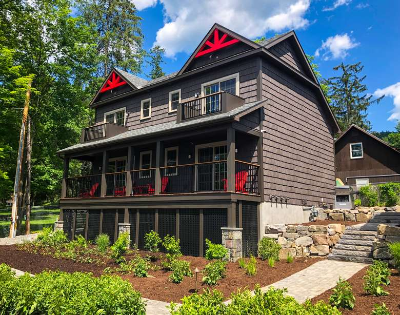 brown house with red accents