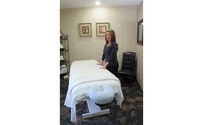 woman standing by massage table