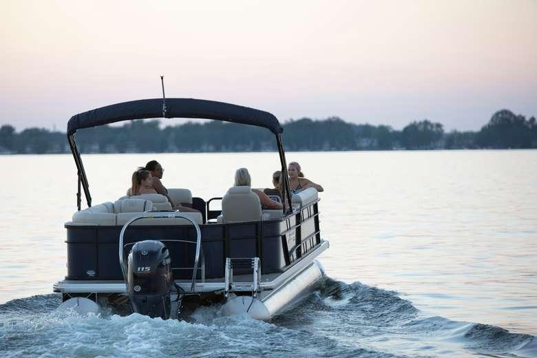Family on a pontoon boat at sundown
