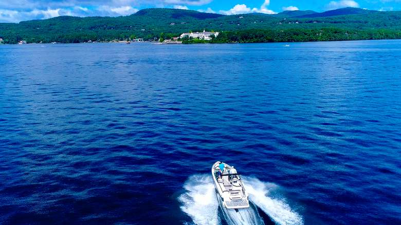 A boat on Lake George on a sunny day