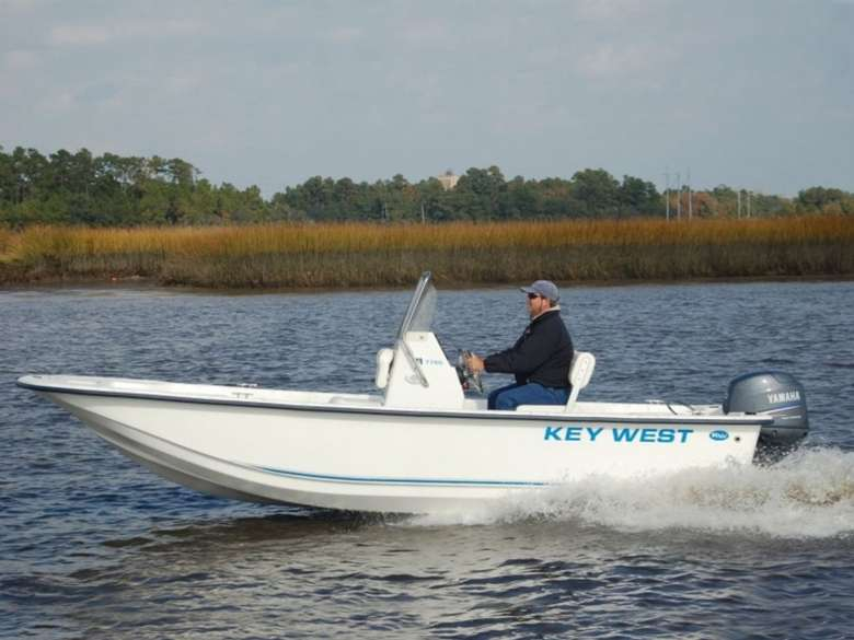 person driving a motor boat