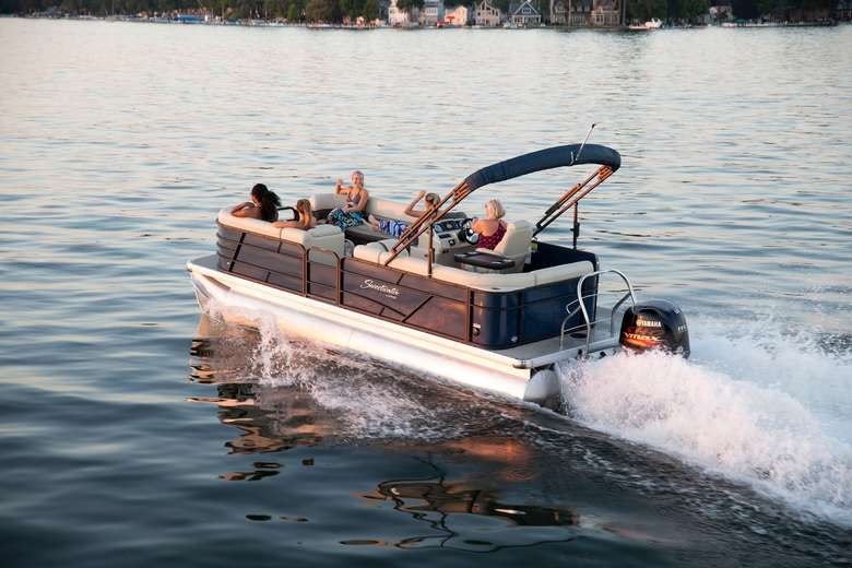 five people in a pontoon boat