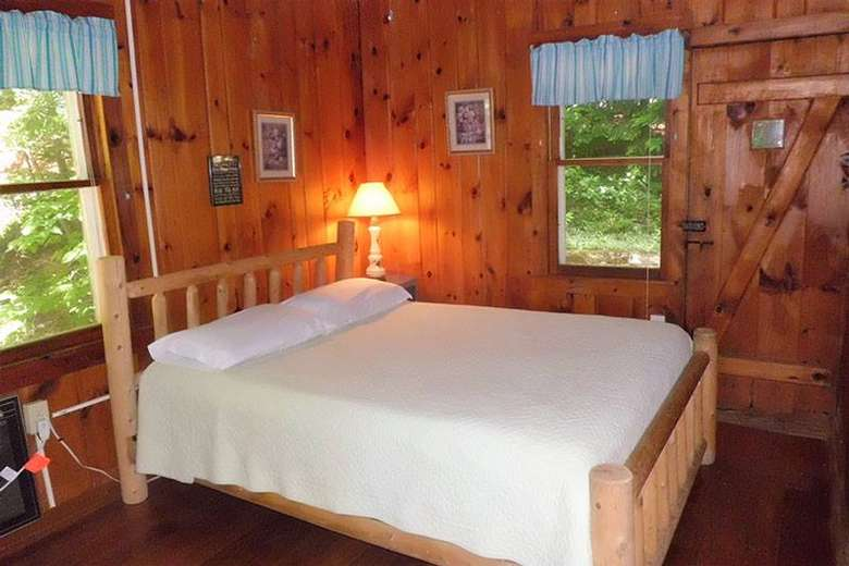 large white bed with a rustic wooden frame