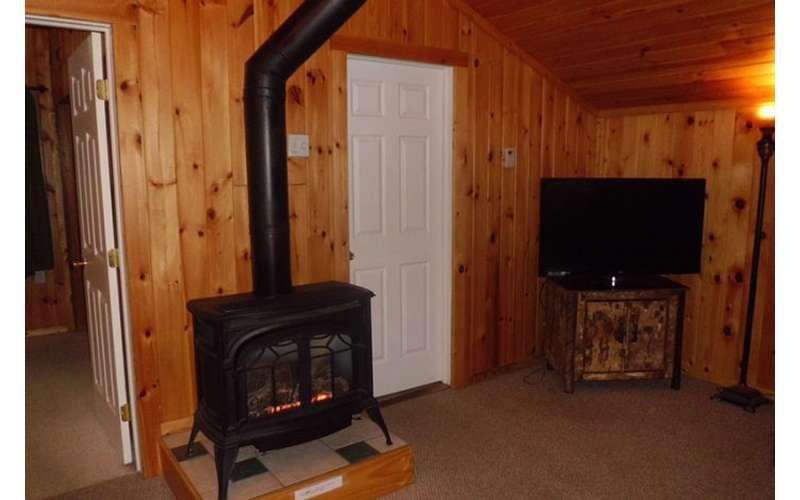 black fireplace near a tv