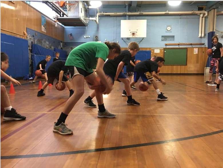kids dribbling basketballs