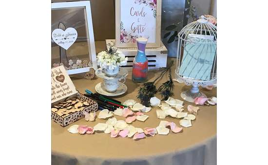 wedding decor and gifts on a table