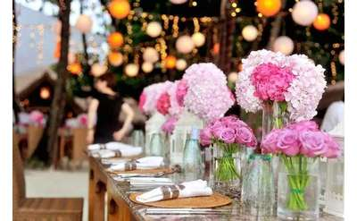 pink flowers in vases on a table