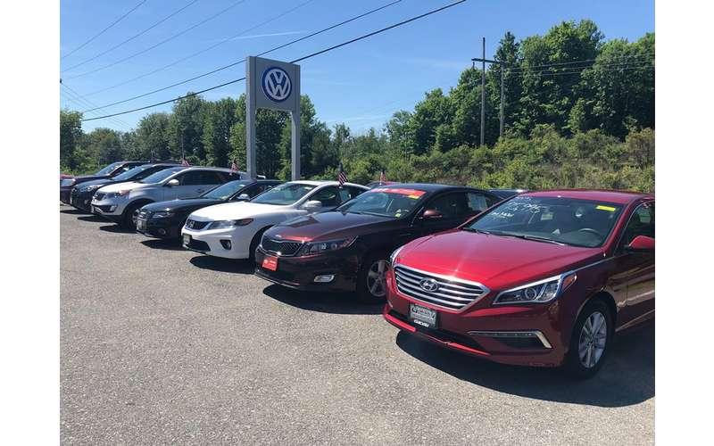 row of cars in a volkswagen dealer lot