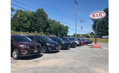 a kia dealer outdoor car lot