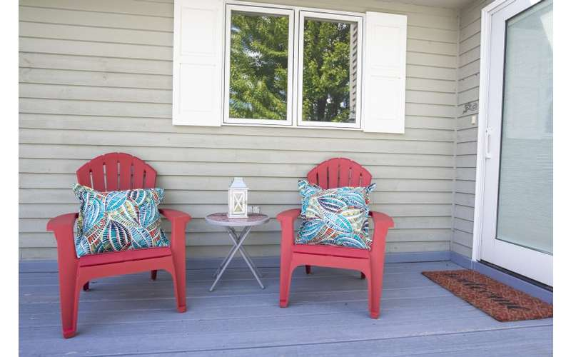 two chairs on porch