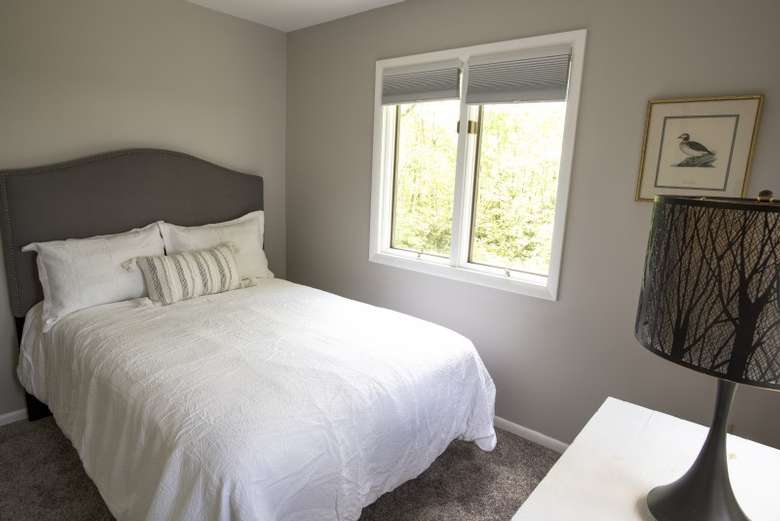 bedroom with bed and lamp