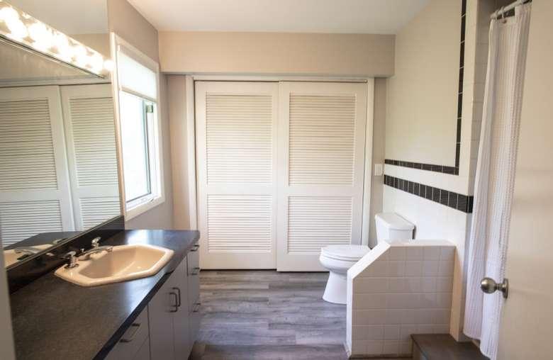 large white closet doors near toilet