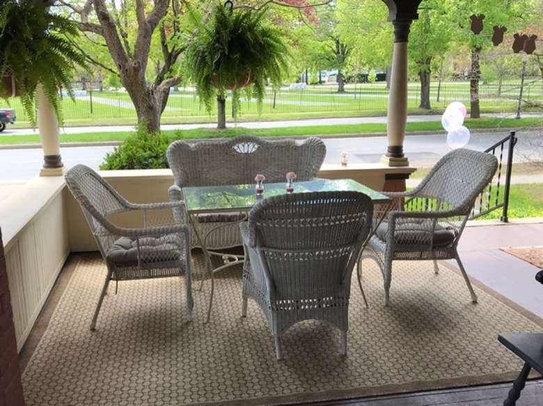 four patio chairs around a table