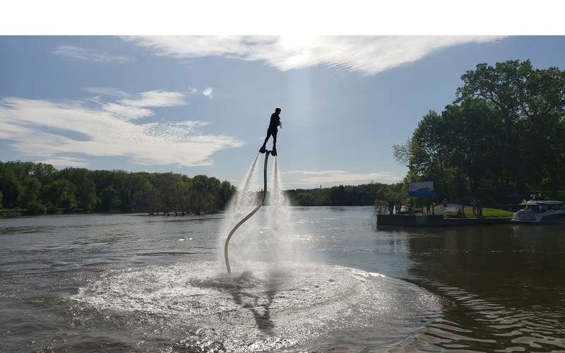 person doing hydroflight over lake