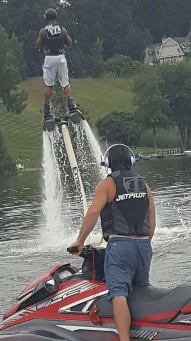 person on jetski and person in hydroflight
