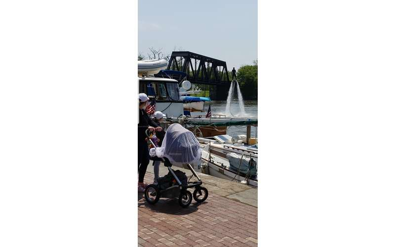 person with baby carriage watching hydroflight