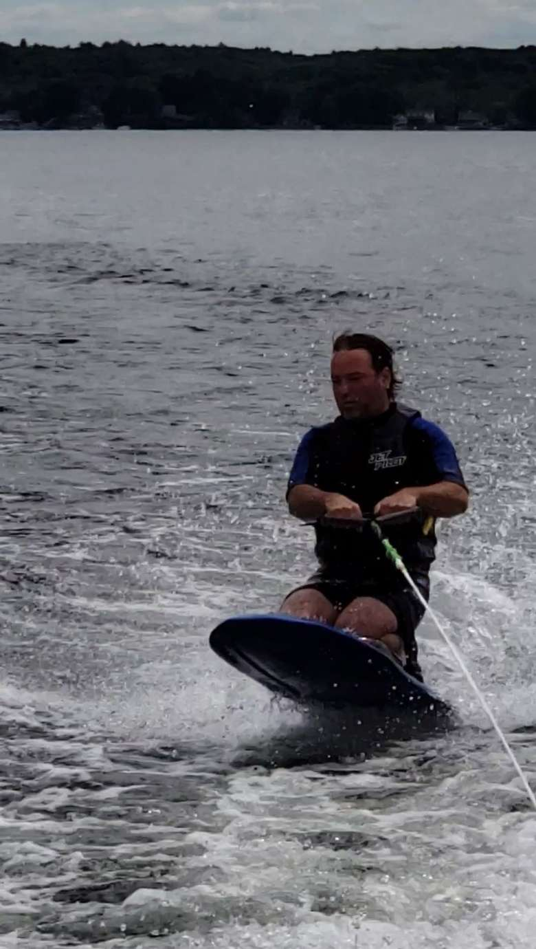 man wakeboarding on the lake
