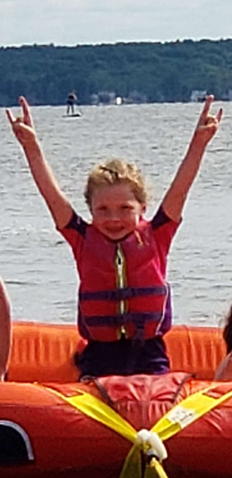 smiling young boy tubing with Extreme Hydroflight services