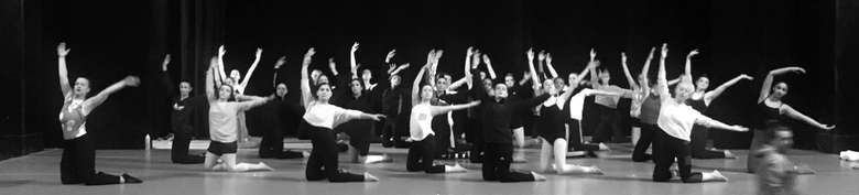 black and white photo of dancers on stage