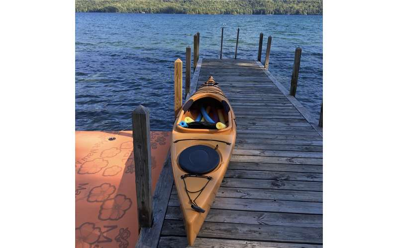 yellow kayak on a boat dock