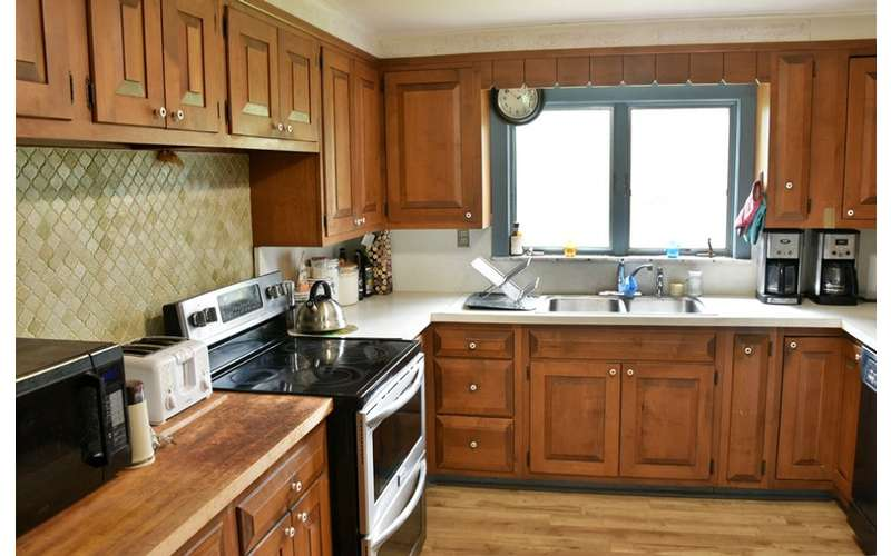 kitchen with sink, oven, and other appliances