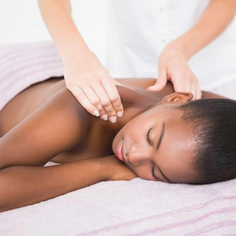 woman receiving a shoulder massage