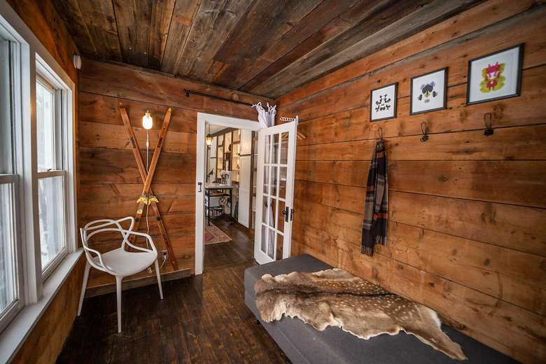 sunroom with wooden walls warners camp cabin whiteface mountain