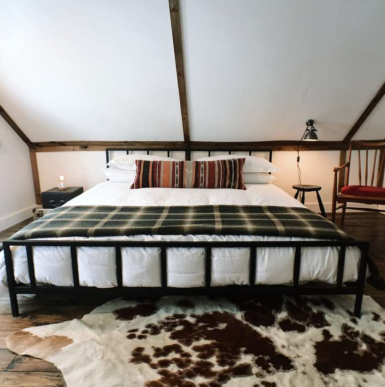 foot of a wide bed warners camp cabin rental lake placid
