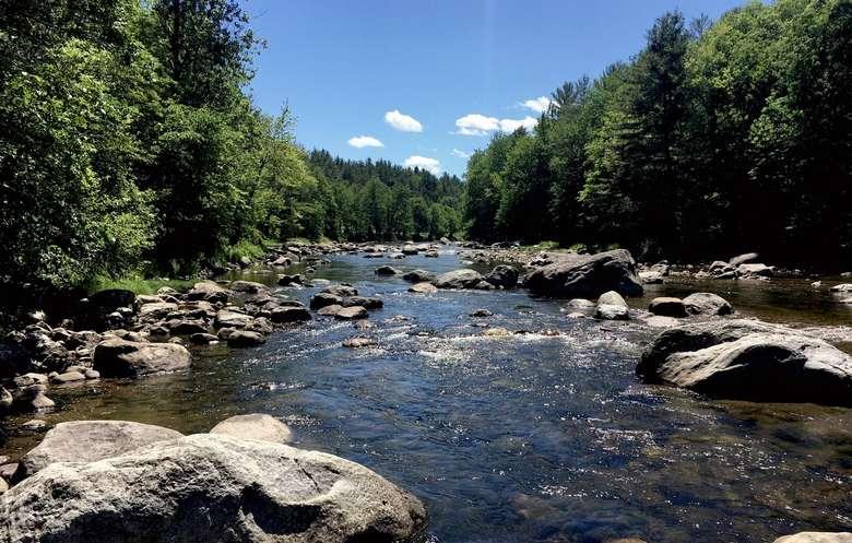 beautiful river with rocks warners camp cabin rental pet friendly Adirondack getaway