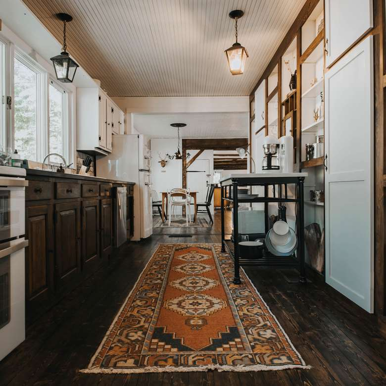 kitchen area filled with appliances warners camp adirondack cabin rental airbnb