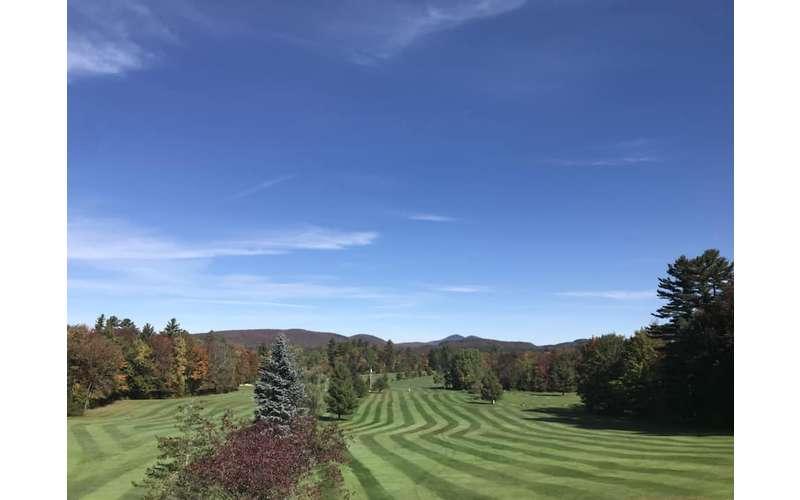 blue sky above a golf course