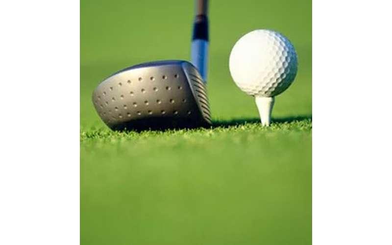 golf club close to a white ball