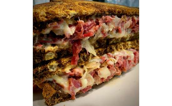 Our mouth watering Reuben, stuffed full with corned beef, sour kraut, swiss cheese and homemade 1000 russian dressing