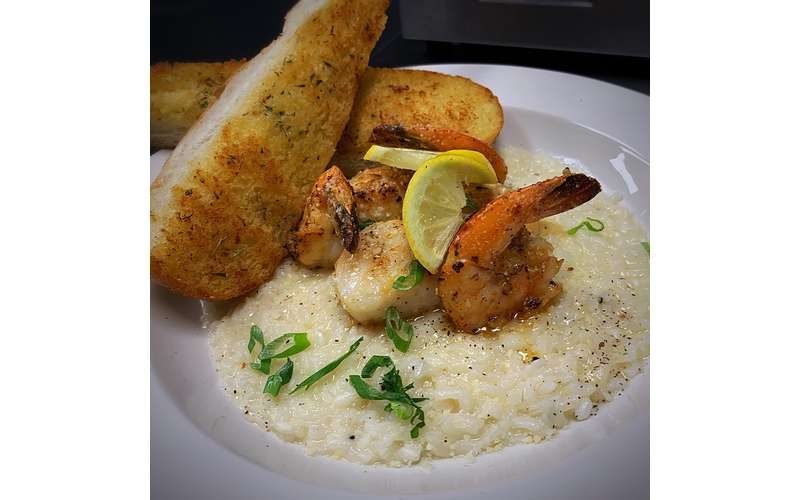 Our Seafood Risotto paired with garlic bread