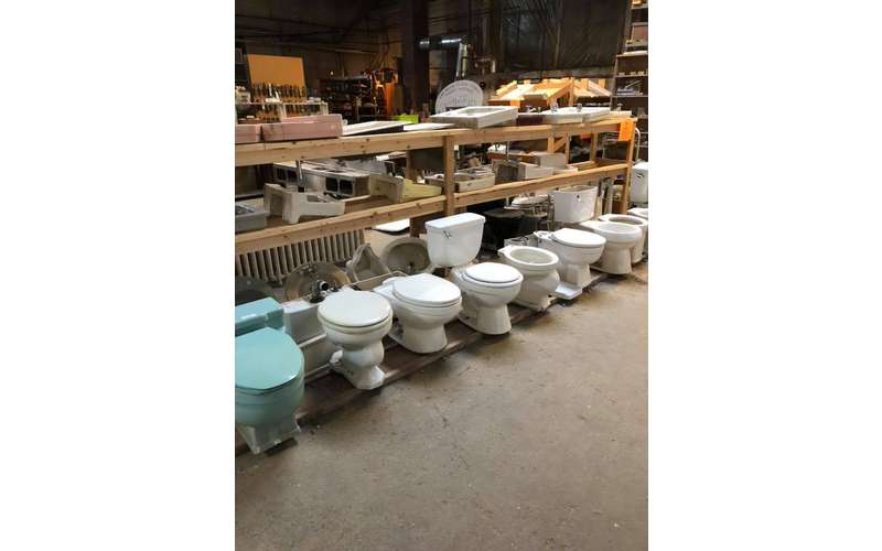 row of toilets in a warehouse