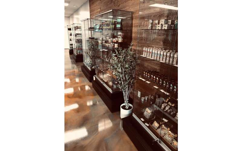 row of glass cases with shelves of cbd products inside