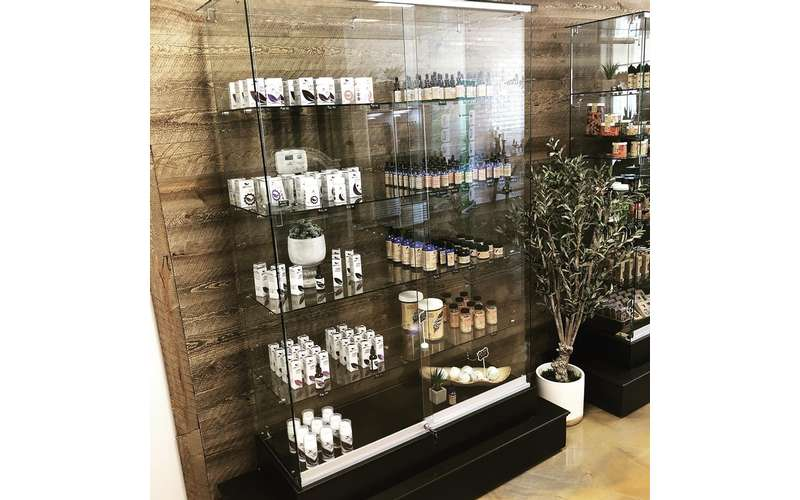 glass case with shelves of cbd products